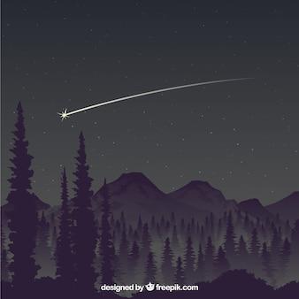 Estrela que cai sobre as montanhas