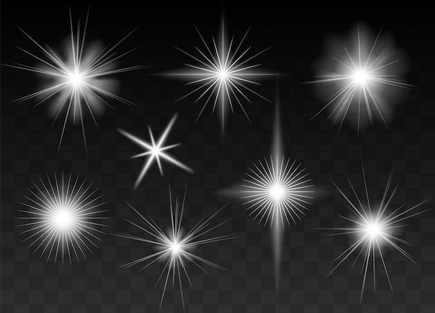 Estrelas brilhantes, brilhos, flashes de luz, conjunto de purpurina brilhante. fundo preto meio transparente. elementos gráficos para cartões e convites de natal e aniversário. adiciona um toque luxuoso aos seus designs.