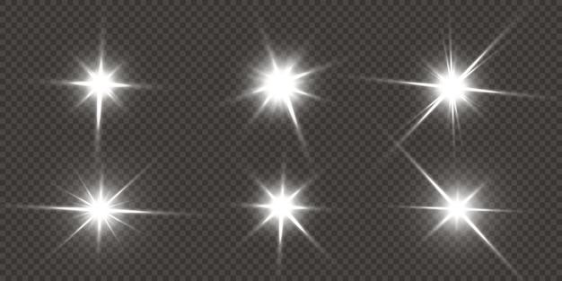 Estrelas brilhantes isoladas em um fundo branco transparente Vetor Premium