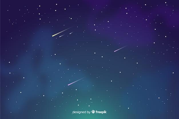 Estrelas cadentes em um céu noturno gradiente