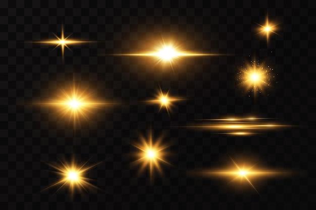 Estrelas douradas brilhantes em fundo transparente