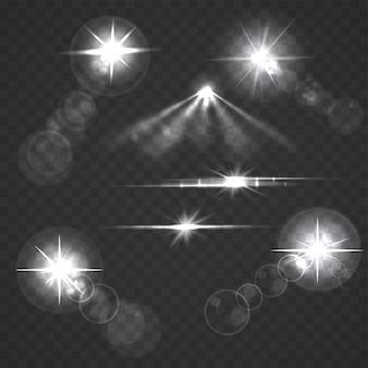 Estrelas e flashes brilhantes do efeito da luz em transparente