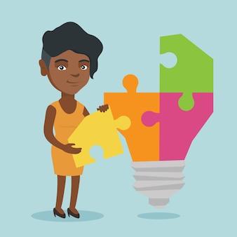 Estudante afro-americano, completando a lâmpada de ideia