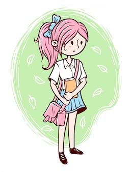 estudante bonito segurando uma ilustração do livro