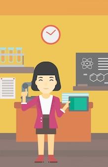 Estudante fêmea que usa o tablet pc na sala de aula.