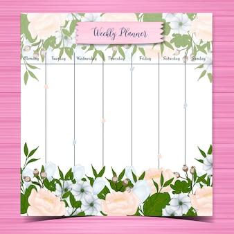 Estudante planejador semanal com lindas flores brancas