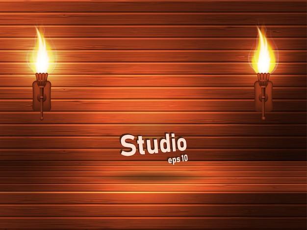 Estúdio marrom de madeira vazio com um tinge e um rebaixo vermelhos.