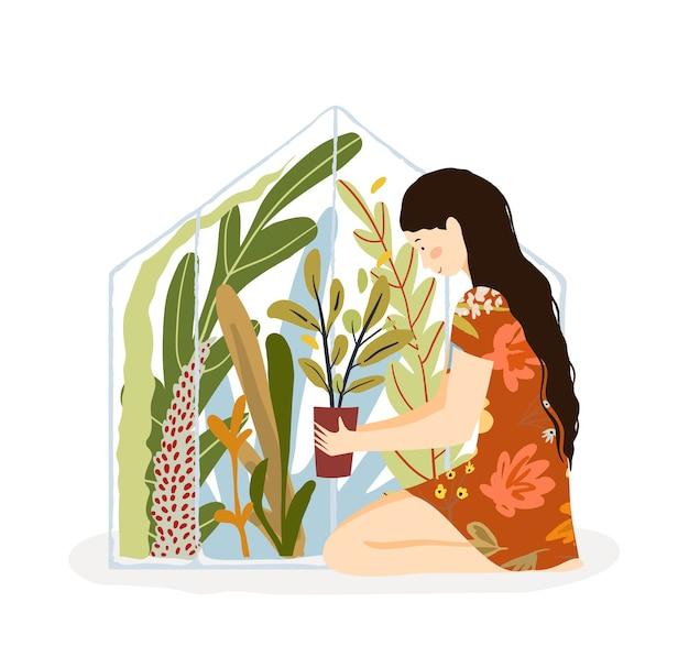 Estufa e mulher sentada segurando vaso de flores, jardinagem em estufa.