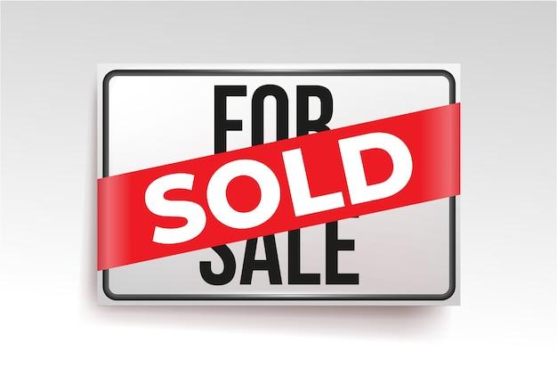 Etiqueta de sinal vendida. palavra de vendido em uma fita vermelha.