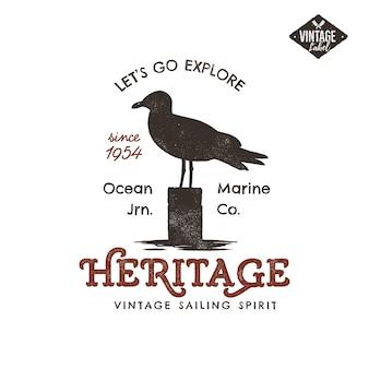 Etiqueta desenhada mão vintage. símbolo da gaivota. efeito da tipografia.