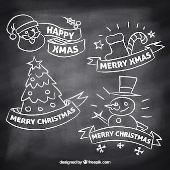 Etiquetas de natal desenhadas à mão no efeito quadro-negro Vetor grátis