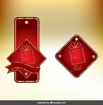Etiquetas de natal em cores vermelhas e douradas