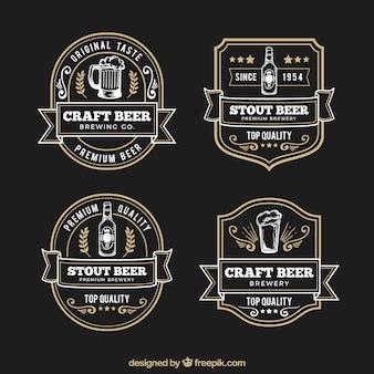 Etiquetas desenhadas mão retro elegantes da cerveja