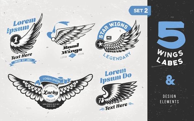 Etiquetas, emblemas, texto e elementos vintage com asas.