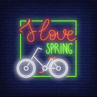 Eu amo o signo de néon da primavera. bicicleta clássica no quadro verde. anúncio brilhante da noite.