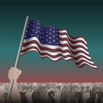 Eua acenando uma bandeira na mão entre a multidão.
