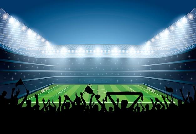 Excited multidão de pessoas em um estádio de futebol.
