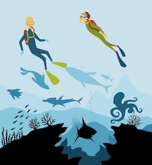 Exploradores de mergulho e vida selvagem subaquática de recife.