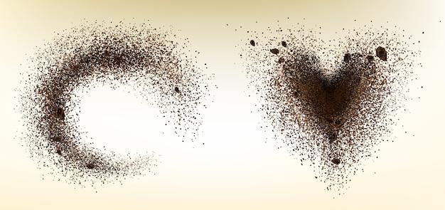 Explosão de grãos de café e pó em forma de coração e círculo.