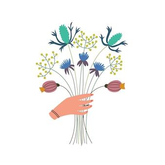 Exuberante buquê de flores silvestres nas mãos