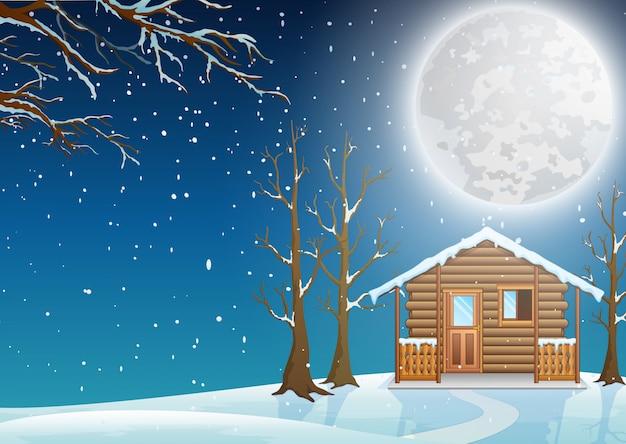 Fabulosa casinha na neve na paisagem de inverno