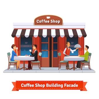 Fachada de construção de café com letreiro