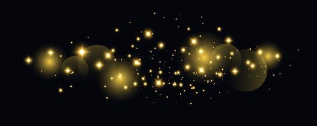 Faíscas amarelas brilham efeito de luz especial. brilha em fundo transparente. padrão abstrato de natal. partículas de poeira mágica cintilante -