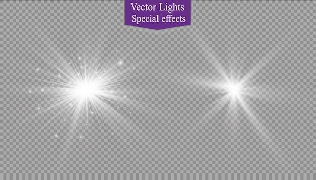 Faíscas brancas brilham efeito de luz especial. brilha em fundo transparente. padrão abstrato de natal. partículas de poeira mágica cintilante