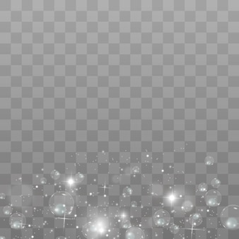 Faíscas brancas e estrelas douradas brilham com efeito de luz especial. brilha em fundo transparente. padrão abstrato. partículas de poeira mágica cintilantes