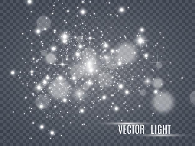 Faíscas brancas e estrelas douradas brilham efeito de luz especial. brilha em fundo transparente. padrão abstrato de natal. partículas de poeira mágica cintilante