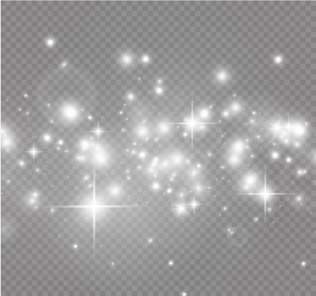 Faíscas brancas e estrelas douradas brilham efeito de luz especial. brilha em fundo transparente ...