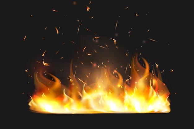 Faíscas de fogo vermelho voando. queima de partículas brilhantes. chama de fogo com faíscas no ar durante uma noite escura.