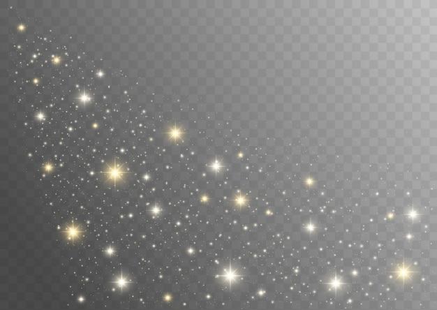 Faíscas de poeira e estrelas douradas brilham com luz especial. poeira brilha em um fundo transparente