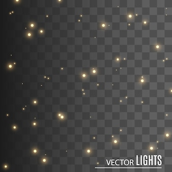 Faíscas e estrelas douradas brilham com efeito de luz especial. brilha em fundo transparente. partículas de poeira mágica cintilantes