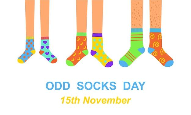 Faixa de dia com meias ímpares pés de homem, mulher e criança em diferentes meias coloridas