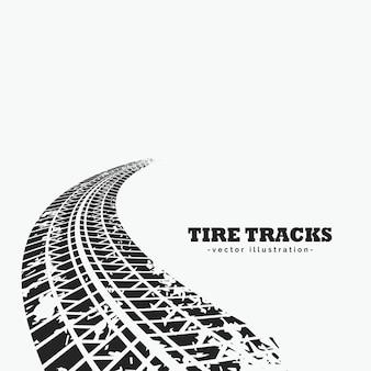 Faixas de pneus sujos desaparecendo no horizonte