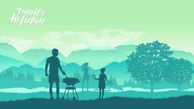 Família acampando e fazendo churrasco na natureza