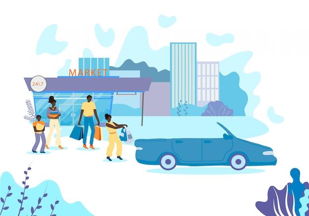 Família afro-americana transporta as compras para o carro.