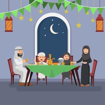 Família árabe feliz desfrutando iftar