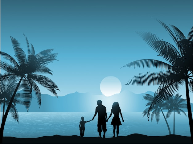 Família caminhando na praia à noite