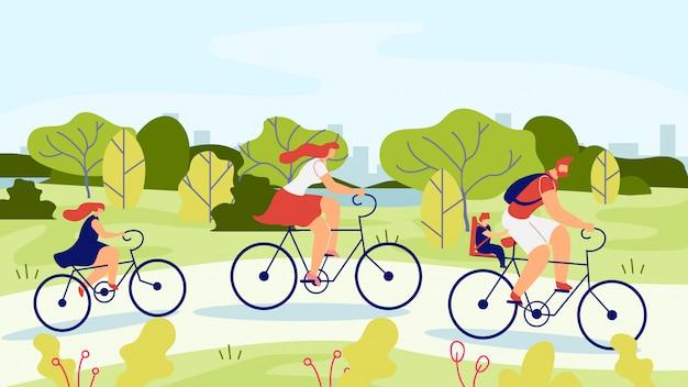 Família com filhos no passeio de bicicleta pelo parque.