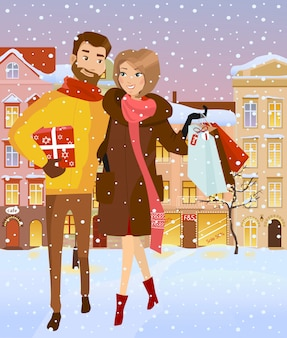 Família com vendas na rua de inverno.