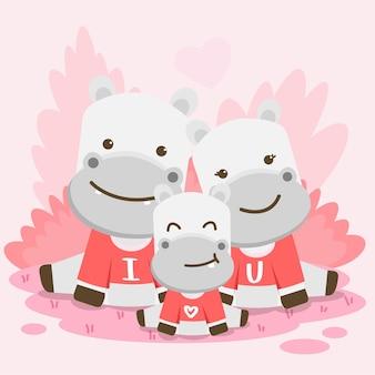 Família de hipopótamos feliz posando junto com o texto eu te amo