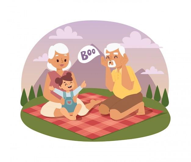 Família de idosos que toma parte num piquenique no verão
