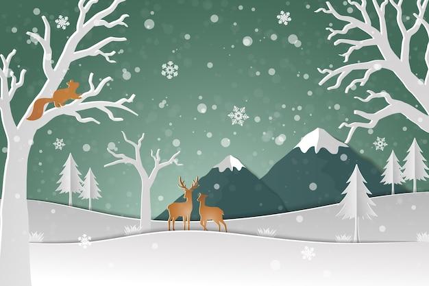Família de veados com neve de inverno na floresta
