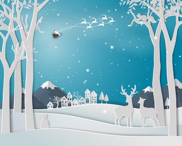 Família de veados na temporada de inverno com paisagem urbana da cidade na arte de papel