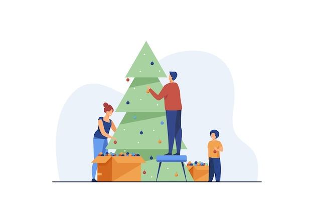 Família decorando a árvore de natal juntos.