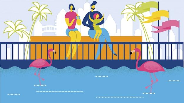 Família dos desenhos animados no zoo watch pink flamingo birds