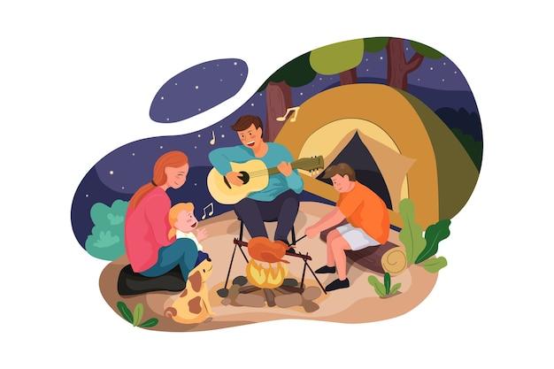 Família feliz aproveitando o acampamento na floresta
