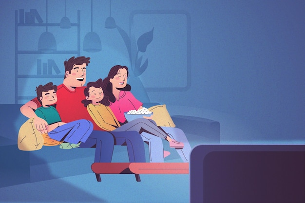 Família feliz assistindo tv juntos